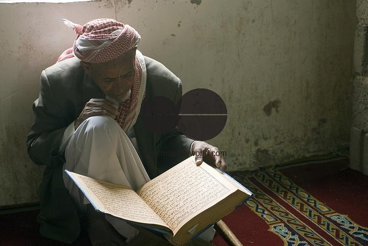 Yemen. Man at Prayer Old Mosque Shibam Kawkaban.
